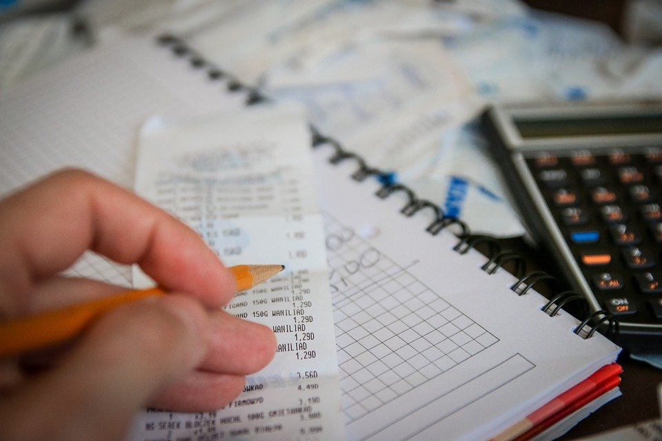 A man noting down his expenses as part of tax planning